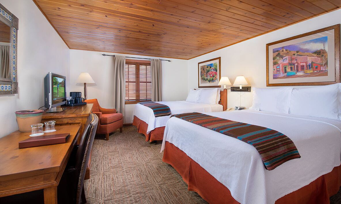 Traditional hotel room with double beds